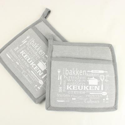 Foto van Set van 2 grijze pannenlappen met tekst