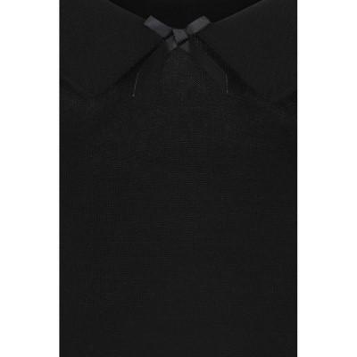 Foto van Truitje Babette, met wijde hals en strikje, zwart
