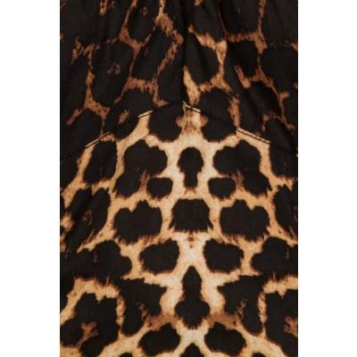 Foto van Top Uma, met luipaard print