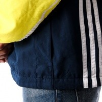 Afbeelding van Adidas AUTH ANORAK DH3842 jas SHOCK YELLOW/COLL.NAVY