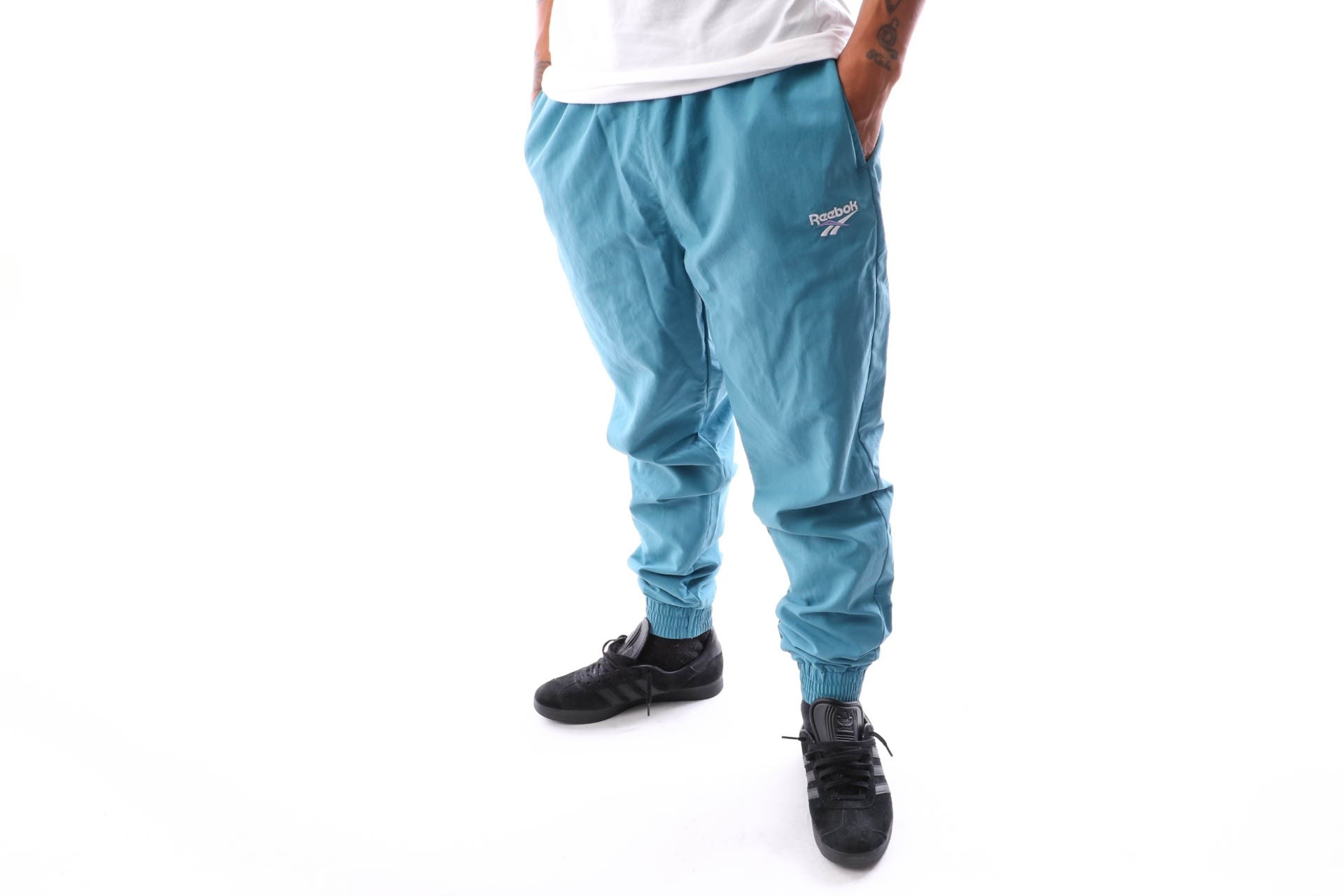Foto van Reebok Cl Vector Unisex Trackpant DX0954 Trackpant mineral mist