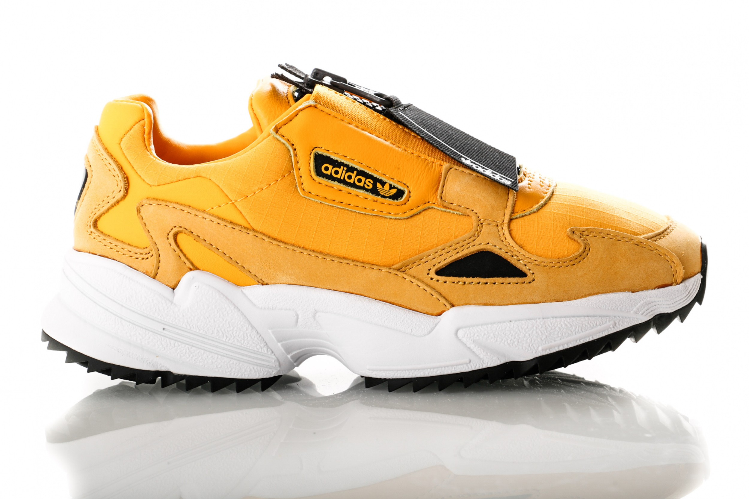 Foto van Adidas Falcon Zip W Out Loud Pack Ee5113 Sneakers Active Gold/Core Black/Ftwr White